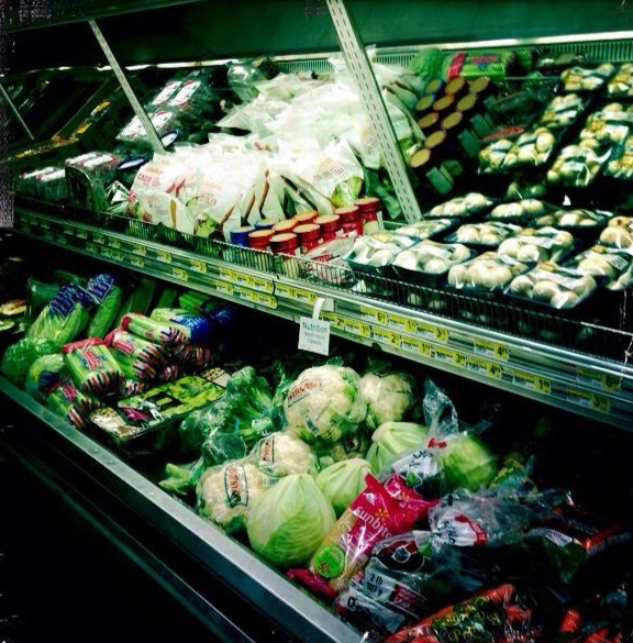 Infrastructures that may lower transport costs of food might also result in change of resource use, land use , harvest of fish and wildlife as well as change of lifestyles. Here are store in Nunavut. Photo: Ann E. Lennert
