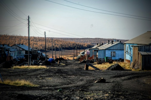 Novaya, a commercial hunting and fishing community of the Dolgan and Nganasan people. Unlike North Amerika, it is aloud to earn a living from commercial hunting. The roads of the town are black of dust from burning charcoal for heating and electricity (Photo: Dorothee Ehrich).