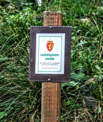 Small signs in the landscapes indicate protected areas (Photo: Sigrid Engen).